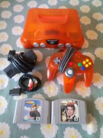 Nintendo 64 Fire Orange console with expansion pack, excellent condition