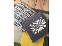Two John Lewis knitted fairisle cushions, with reversible design. Christmas cushions!