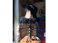 Beautiful lamp with antique metal base and faux animal pattern shade trimmed with black ostrich fur.