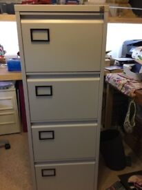 Full size 4 drawer filing cabinet with key. Excellent condition.