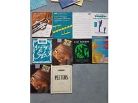 Various books and music for trumpet