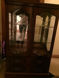 A very good quality glass cabinet with lighting.