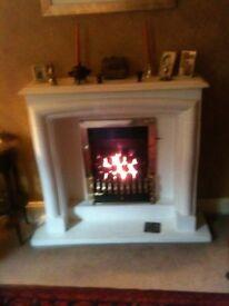 Limestone style fireplace