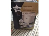 Tommee Tippee steriliser with three bottles and breast hand pump