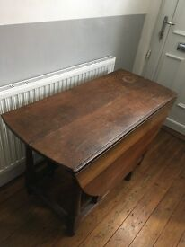 Dining table - Dark wood drop leaf circular