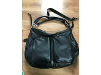 OiOi Black baby changing bag extendable