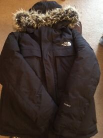 Black coat size L/G, detachable hood. Hyvent padded construction. Hardly worn. £125