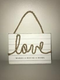 Love makes a house a home wooden plaque