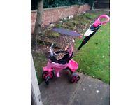 Avigo body trike in pink & black age 9 to 36 months