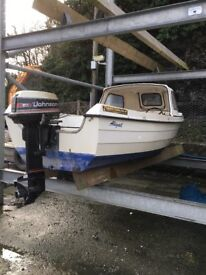 16 ft Orkney strikeliner with a 2 stroke Johnson 25 commercial engine