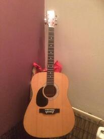 Acoustic guitar left handed