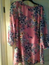 Size 16 floral dress. it looks really nice with thin belt.