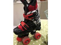 Roller boots 4 wheels size 10-12 good used condition