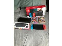 Nintendo Switch Neon, with Mariokart 8 deluxe, super bomberman and case