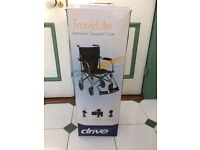 Folding lightweight wheelchair with carry case. New, unused, boxed. Aluminium TRAVELITE chair.