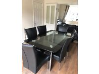 Six seater glass dining table