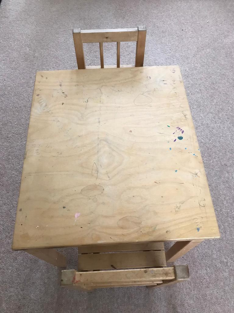 Children's wooden play table with two chairs