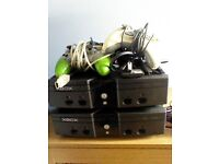 2 xbox originals with all cables and 4 controlers and 54 games all in good con