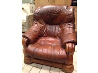 Oak framed leather armchair in need of refurbishment.