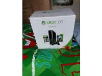 Xbox 360 complete with 32 games, 1 controller and charger