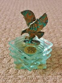 Verdigris Bald Eagle Ornament atop a stack of 6 square glass plinths from America
