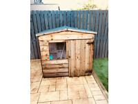 Kids wooden playhouse.