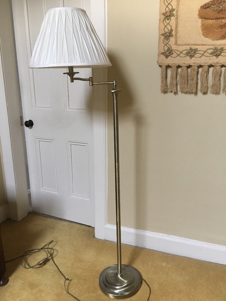 Brass effect standard lamp with flexible arm