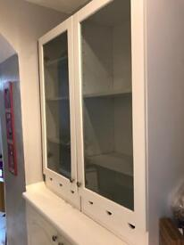 Glass fronted wooden display cupboards