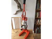 A cast iron hand operated juicer excellent condition