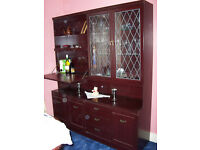 mahogany glass fronted display cabinet shelves,3drawers side cupboards, drop leaf cocktail section