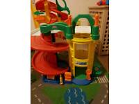 2 Fisher price car garages and a car mat