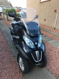 Piaggio mp3 300 touring on car driving licence