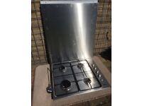 Zanussi 4 burner gas hob and stainless steel splash back.