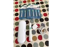 Philips Sonicare electric toothbrush + 6 heads