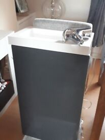 Bathroom sink unit with tap and resin basin