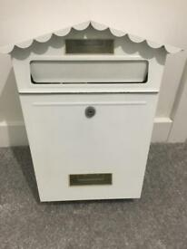 White mail box with key