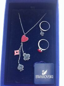 limited edition Swarovski Alice in Wonderland matching necklace and two ring set