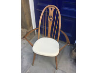 Ercol Armchair with swan motif from Windsor range in good condition. feel free to view