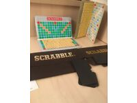 Two magnetic travel scrabble boards each designed for four players