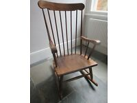 Beautiful solid wood vintage 1970's rocking chair.