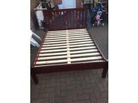 Wooden brown double bed with mattress