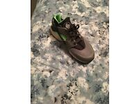 Grey and green Nike huaraches