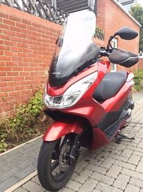 RED HONDA PCX with EXTENDED WINDSCREEN
