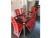 Modern Glass/Black/Chrome dining table with 6 red chairs *Barely used*