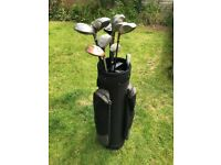 Array of golf clubs and golf bag