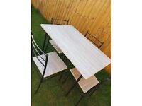 Immaculate dining table with 4 chairs
