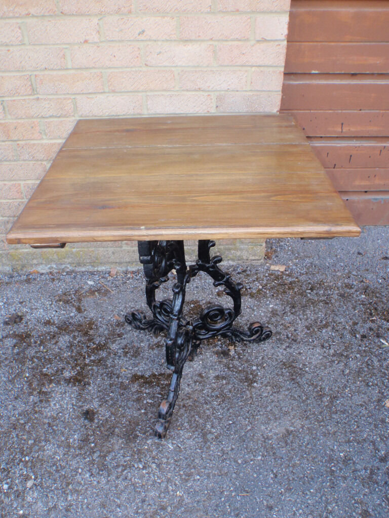 With massive wood top and iron cast base - Vintage Cast Iron Base Solid Wood Plank Top Square Bistro Patio Garden