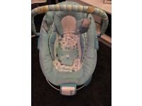 Baby blue baby bouncer with music and vibrations