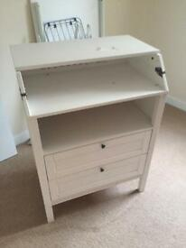 A Ikea changing table with cabinet