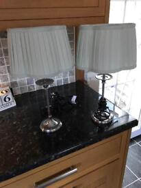 Two chrome candle stick lamps. New.